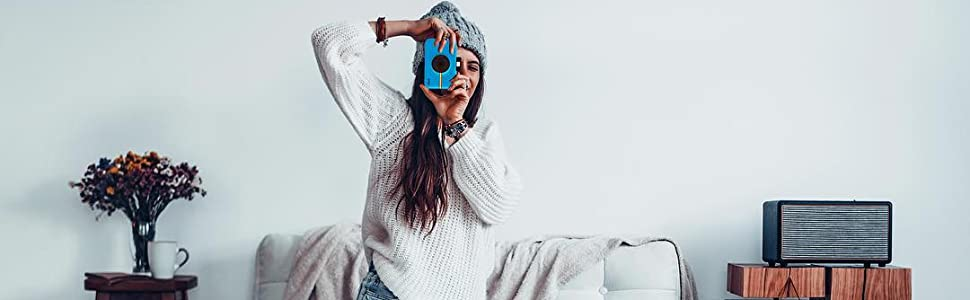 blue camera with young woman taking a photo