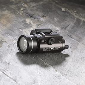 Streamlight 69260 TLR-1 High Lumen Rail-Mount Tactical Light, Black, set on slate stone surface.