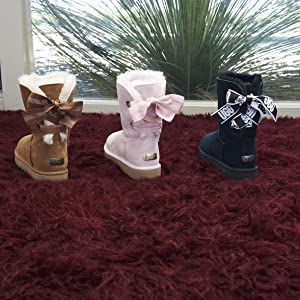 98c72174eba UGG Women's W Customizable Bailey Bow Mini Fashion Boot
