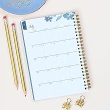 blue sky bakah blue academic planner,closeup of monthly layout,desk setup with pencils