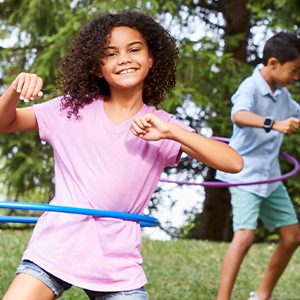 kids playing hula hoop on playground