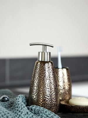 Extravagant soap dispensers and dishes, toothbrush tumblers, cosmetic jars, hooks, racks