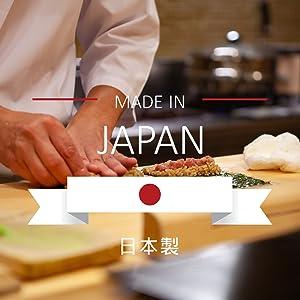 Kyocera Advanced Ceramic Revolution Series 7-inch Professional Chefs Knife, Black Handle, White Blade