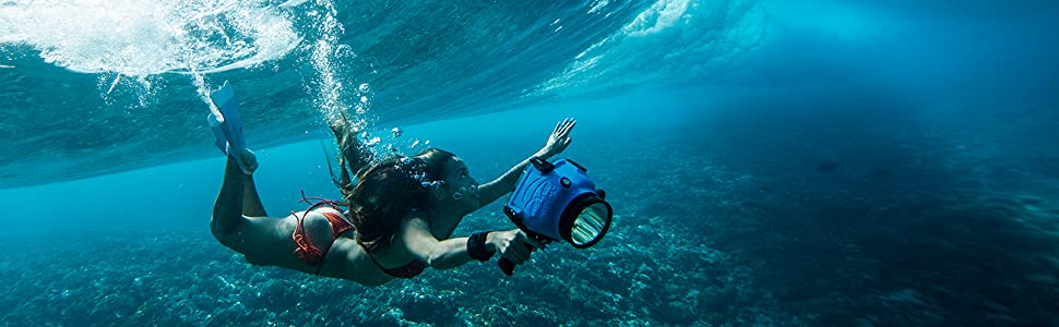 Girl diving in ocean