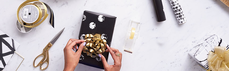 Gold and black gift wrap supplies by Hallmark including ribbon, bows, wrapping paper & tissue paper