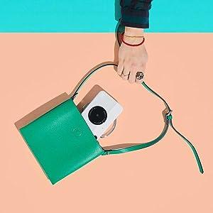 gray camera in green bag