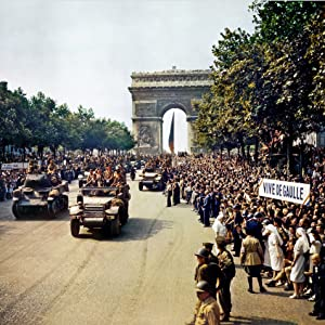 crowds line the champs-elysee as tanks go by after the liberation of paris