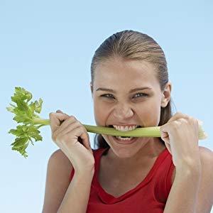 Woman biting celery