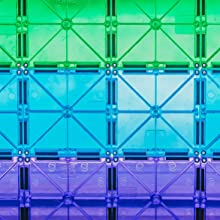 Translucent green, blue, and purple magnetic tiles stacked in rows showing stainless steel rivets