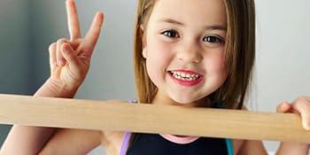 young girl with kip bar