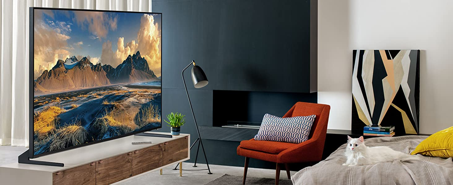 QLED 8K Q900 with a colorful desert scene in a bedroom