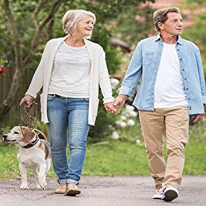 Why It Works Couple walking with dog