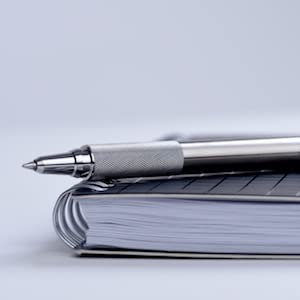 zebra F-701 close-up image, stainless steel retractable ballpoint pen, all metal pen from zebra