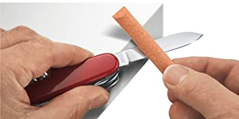SAK Care Tips image of how to sharpen Swiss Army Knife in red with orange stone