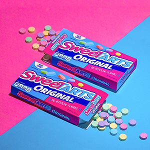 SweeTARTS - Woman holding sour chewies and candy