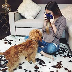 girl snap a photo of dog with purple instant camera