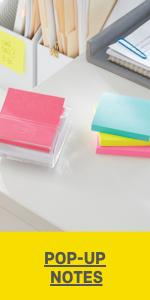 Stacks of Post-it Pop-up Notes with one stack sitting in a clear dispenser.