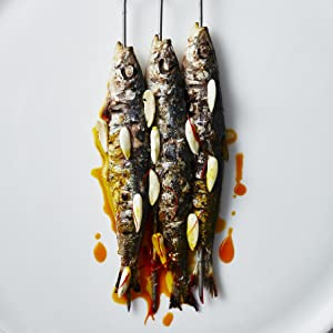 Photo of sardines and garlic on skewers