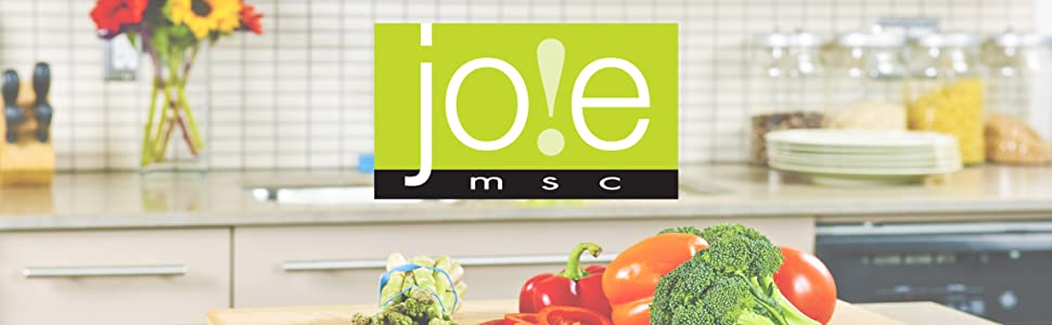 Kitchen setting with fresh veggies on the counter with the joie logo in the middle of the image
