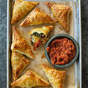 Flaky Andouille and Callaloo Hand Pies with Red Pepper Sambal