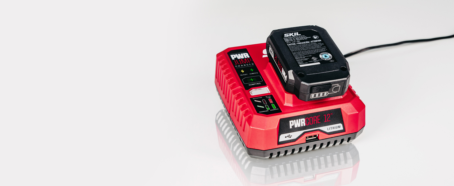Finger pushing the PWRJump button on battery charger
