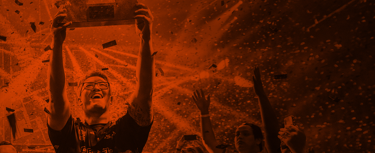 -SteelSeries sponsored player holding up trophy on esports stage with confetti