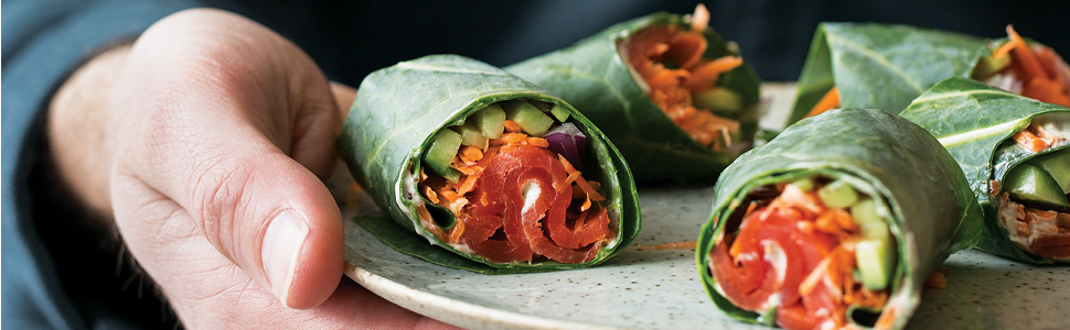 person holding platter of Smoked Salmon Roll Ups