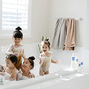 Kids enjoying bathtime with gentle hypoallergenic skin care products with avocado perseose.