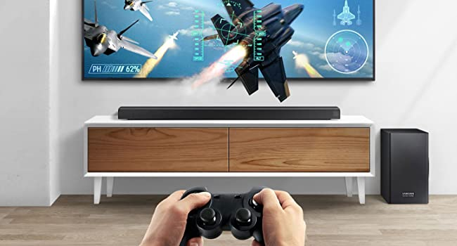 Someone playing a fighter aircraft pilot game on a QLED with the Soundbar below.