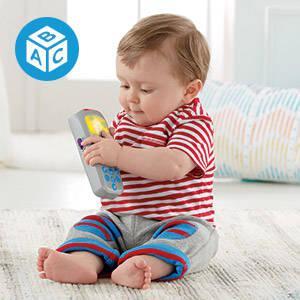 """Mando a distancia de juguete para """"cambiar de canal"""" y aprender con Perrito"""