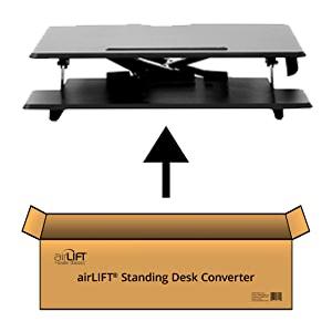 sevilleclassics airlift standing desk converter pneumatic gas spring desk platform top wood black