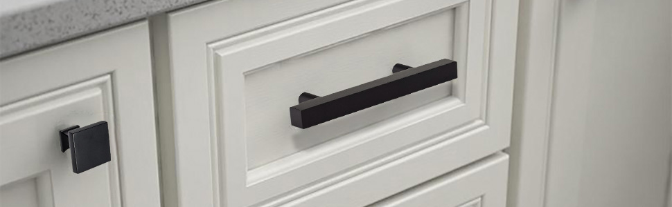 white shaker cabinets with black handles