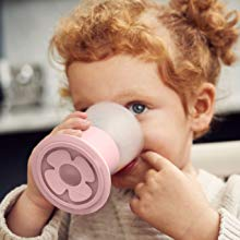 Girl drinking from pink cup