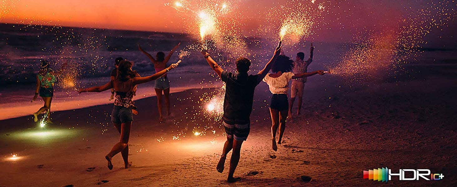 HDR logo overlaid on a scene with kids running down a beach with sparklers