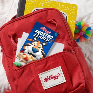 Individual serving sizes of Frosted Flakes fit into kids backpacks along with school supplies, toys
