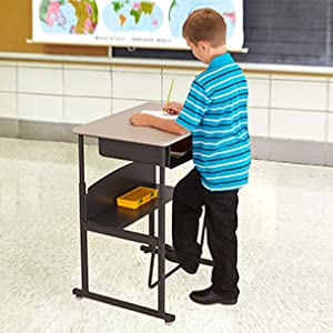 student standing at alphabetter desk