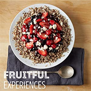 A bowl of fresh mixed berries over quinoa with a Smucker's Fruit Spread salad dressing