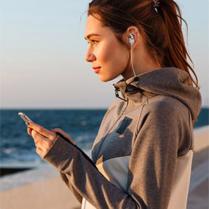 girl listening to music incredible 10 hour battery life ensures non stop music and calls
