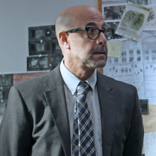 Stanley Tucci as Commissioner Harper