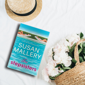 The Stepsister book on a bed with white flowers and sun hat.