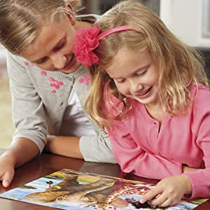 Mother doing daughter puzzle wit