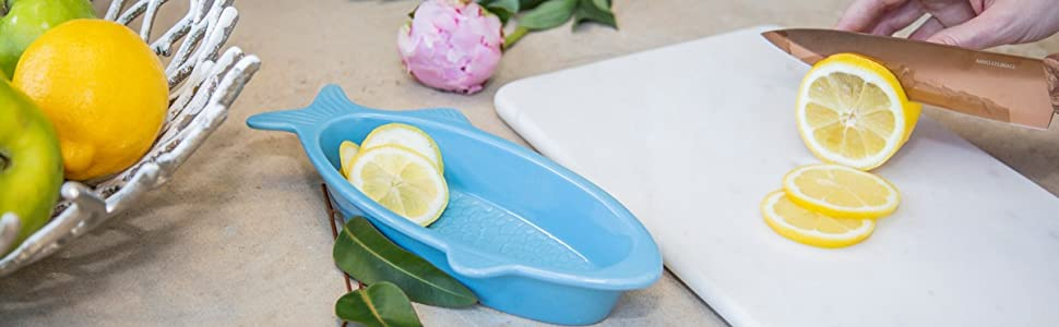 white marble cutting board dip bowl copper knife cambridge fruit bowl basket blue fish lemon apple