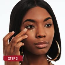 Close-up of a woman's face applying Rimmel Stay Matte Concealer