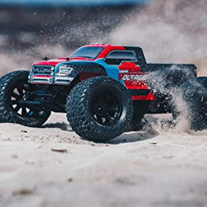 GRANITE VOLTAGE RC Monster Truck in action on sand