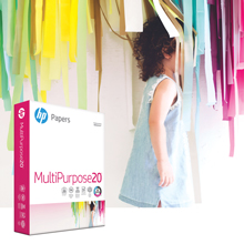 Young girl walking through colorful streamers and a ream of MultiPurpsose20 paper