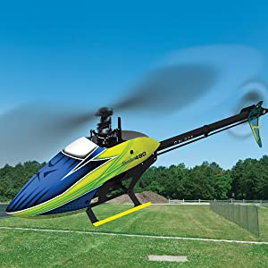 RC Heli in flight with blurred main and tail rotors showing high level of realistic detail