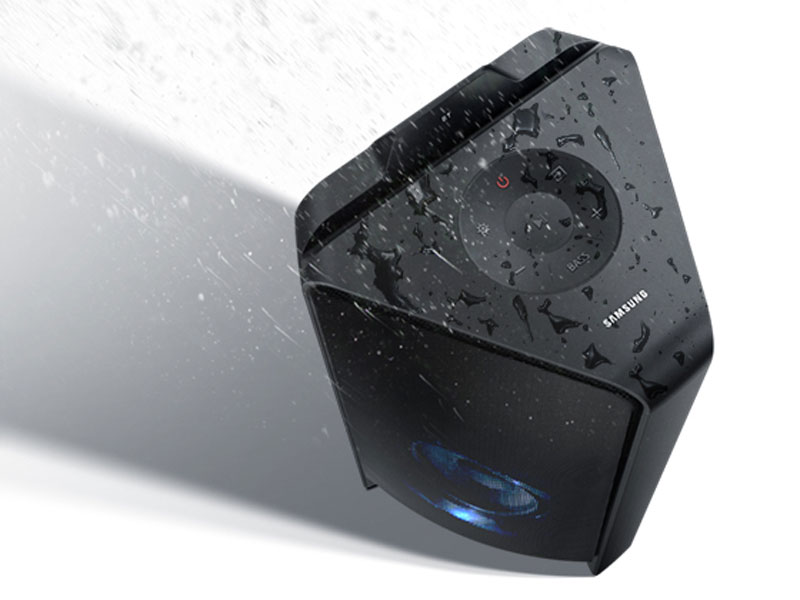 Water being splashed onto the Samsung GIGA Party Soundbar