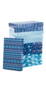 Blue Christmas gift boxes in stripes, snowflakes, ugly sweater pattern, trees and reindeer