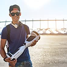 Teen proudly presenting a bluewheel hoverboard