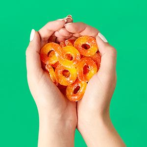 Peach Rings in hand